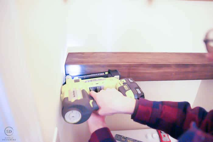 use nail gun to attach front to floating shelves