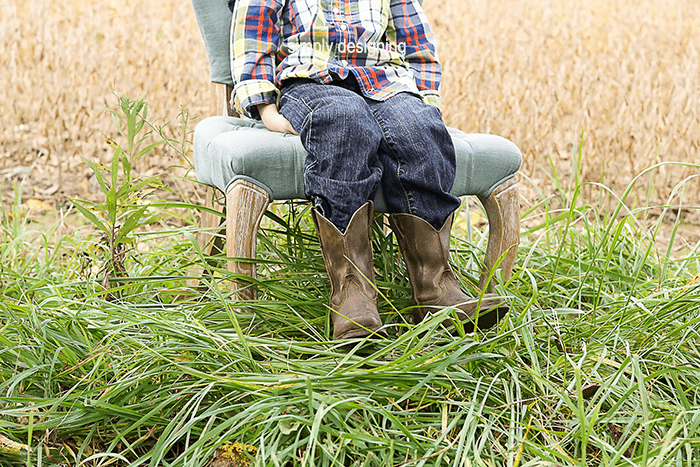 photo of boys legs and Boots in a field