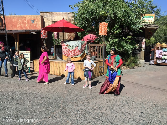 Dancing with performers in the Asia section of Animal Kingdom