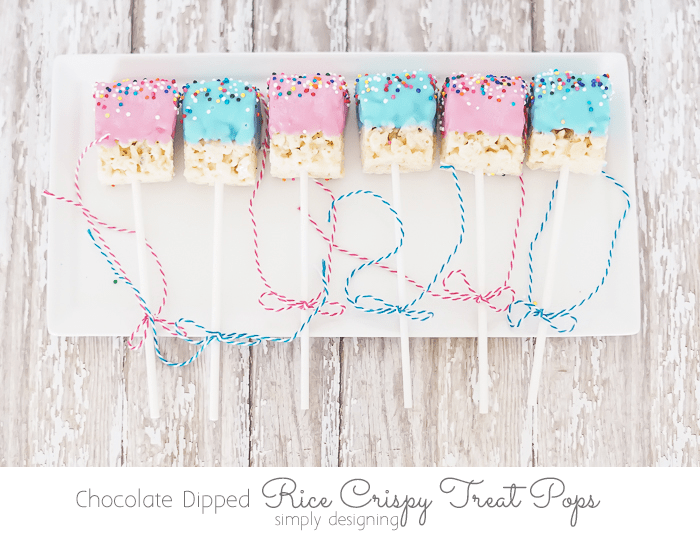a plate of alternating pink and blue Chocolate Dipped Rice Crispy Treat Pop