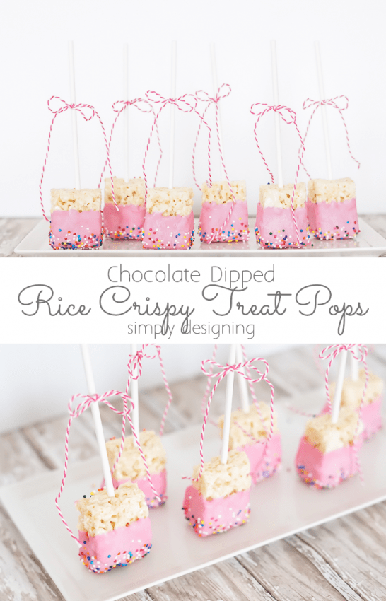 Plate of Pink Chocolate Dipped Rice Crispy Treat Pops on a platter with twine bows on the stems