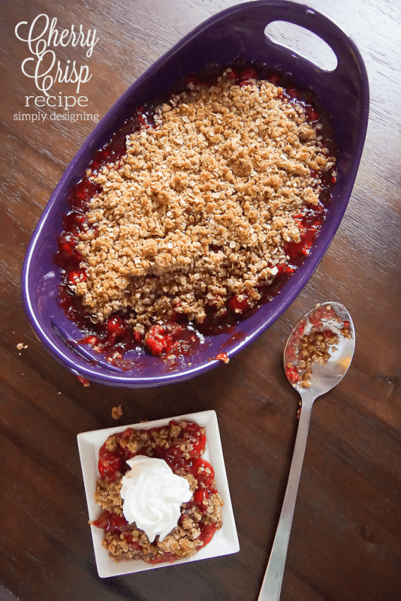 cherry crisp baked in a purple dish and served on a white plate