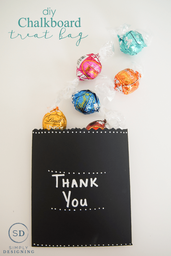 Making your own DIY Chalkboard Treat Bag is a fun way to create your own custom treat bag. And you can write and re-write a note on it because it is made with chalkboard paper.