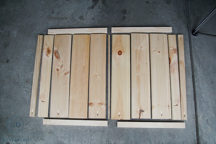 Layout of all wood pieces for DIY Baby Gate with Pocket Holes created with a Kreg Jig