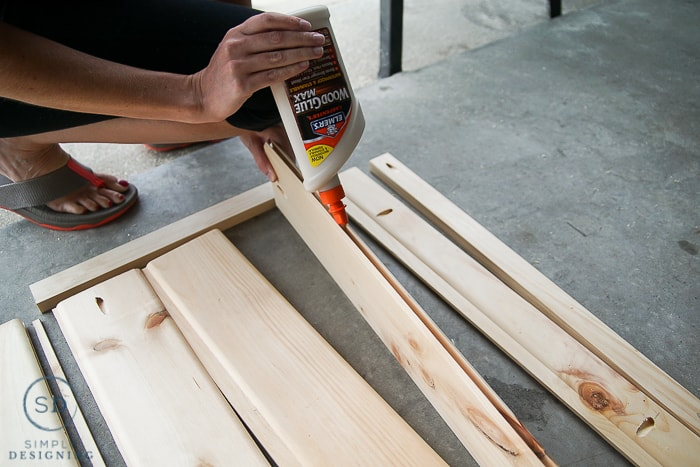 Using Elmer's Wood Glue Max to glue the car siding boards together to make a baby gate