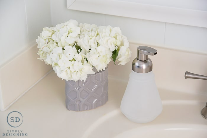 Kids Bathroom Makeover - soap dispenser and flower vase