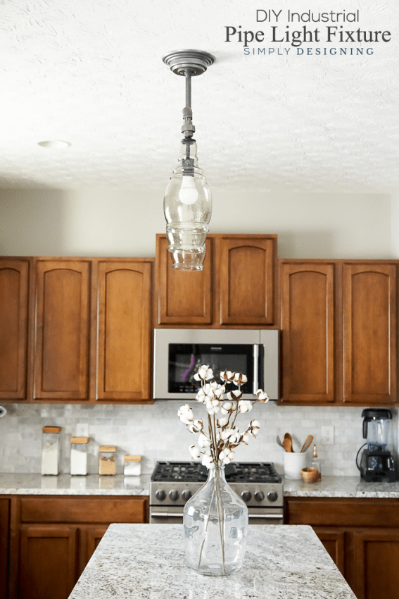 side view of DIY Light Fixture pendent light over kitchen bar with cabinets in the background