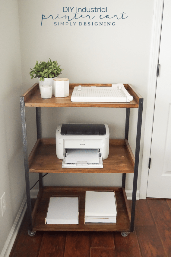 Industrial DIY Printer table with three shelves and caster wheels holding paper, printer, paper cutter and decorative items