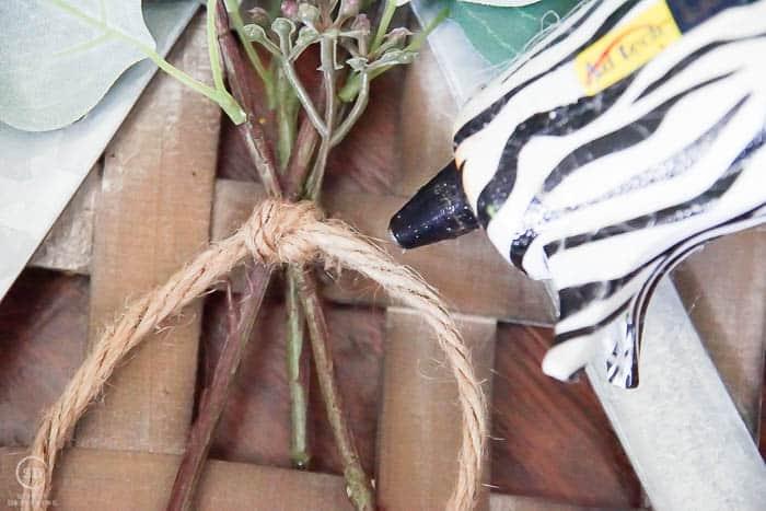 hot glue greenery to tobacco baskets