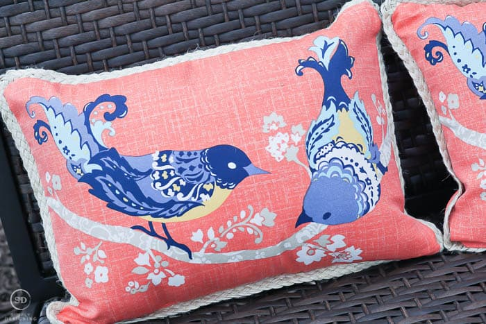 coral pillow with birds