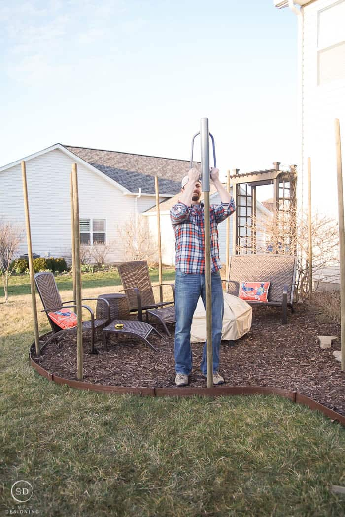 install posts outside around fire pit