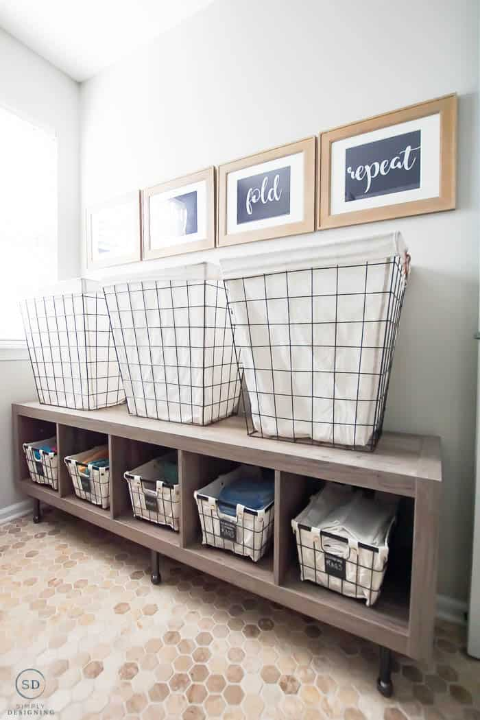 raised laundry basket storage for how to organize a laundry room