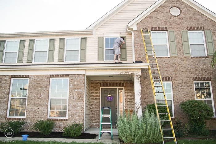 how to paint shutters before removing shutters from second story home
