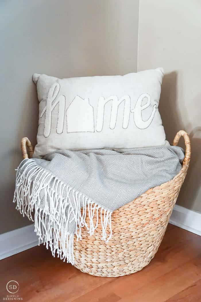 Basket with blanket and pillow in front room makeover