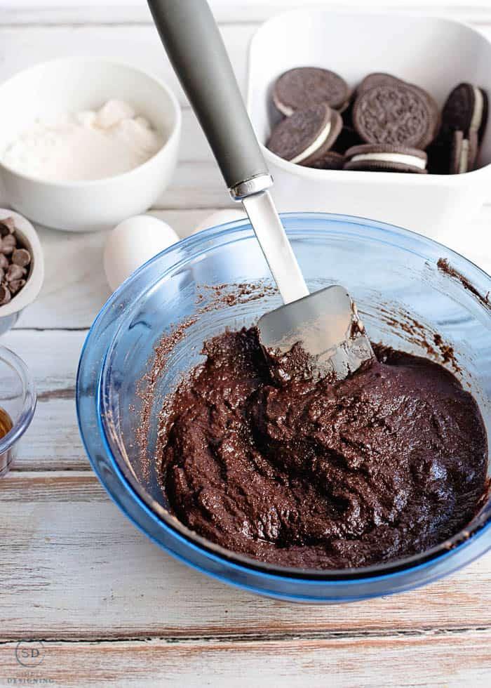 stir brownie ingredients together