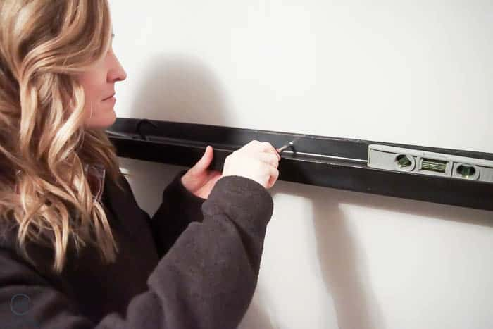 secure metal shelves to wall