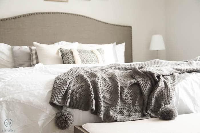 gray pom pom blanket