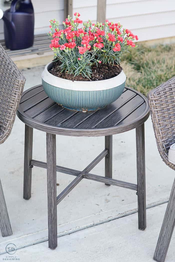 side table and flowers - outside living - patio makeover - how to pot a plant