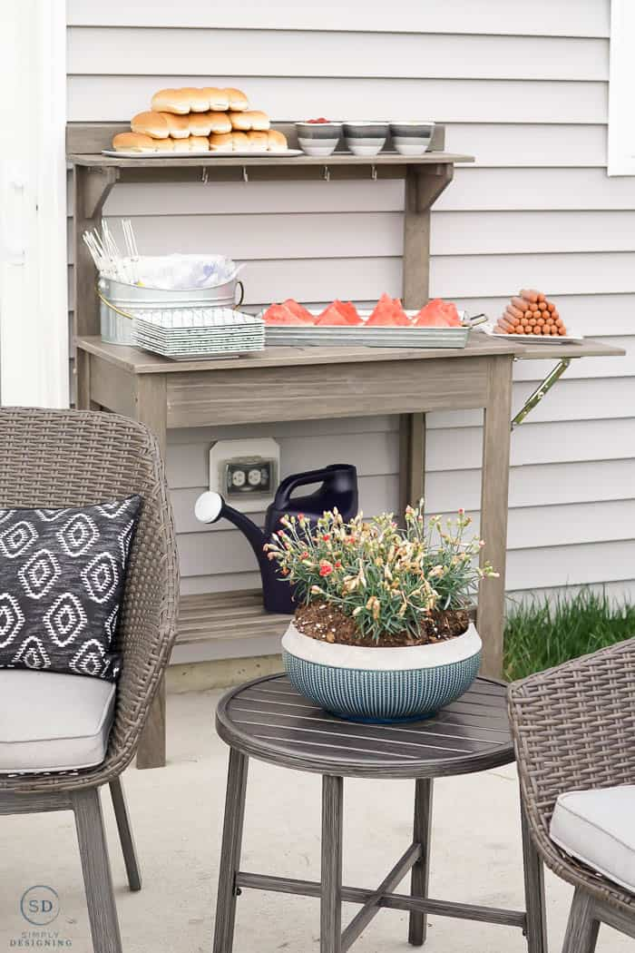 re-purposed planting bench to hold food at summer dinner party