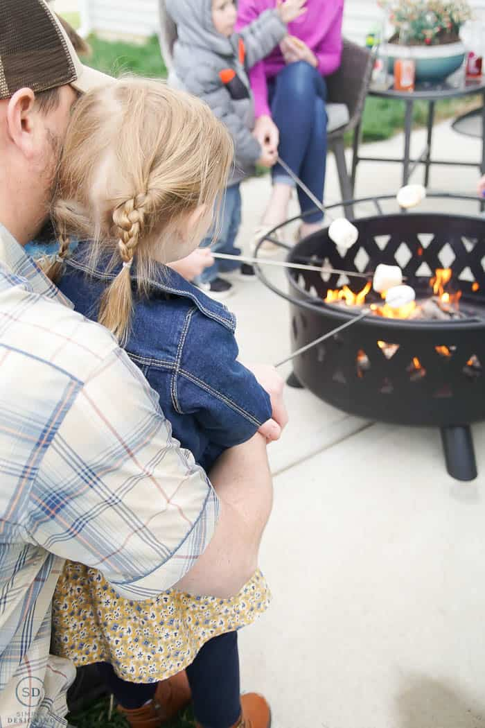 roasting marshmallows at summer dinner party