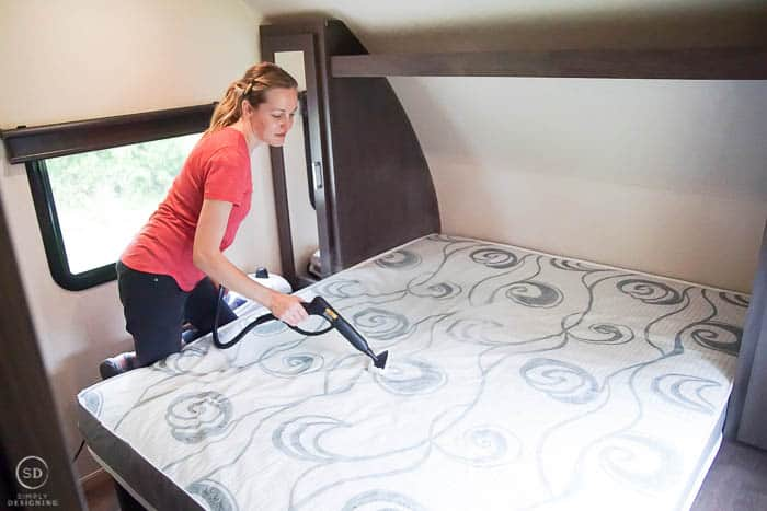 clean and sanitize a bed in an rv or trailer