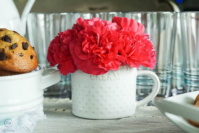 flowers in cream pitcher