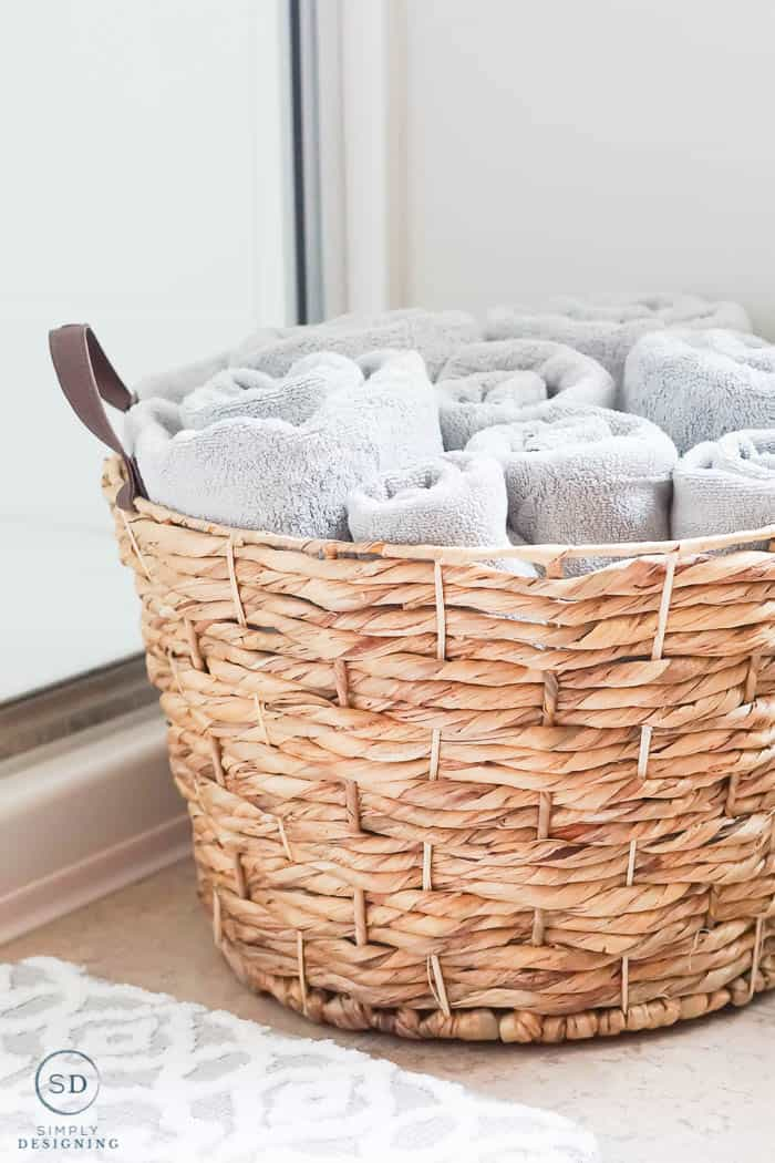 basket with gray towels in it