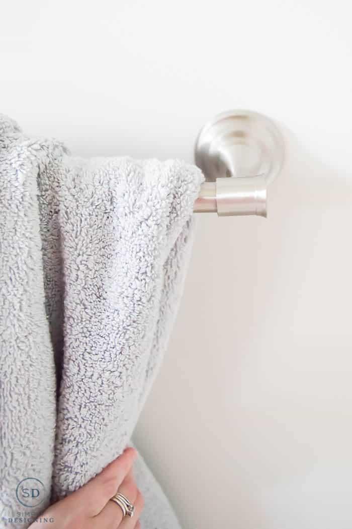 bathroom towels on new towel rack - close up detail of towel rack