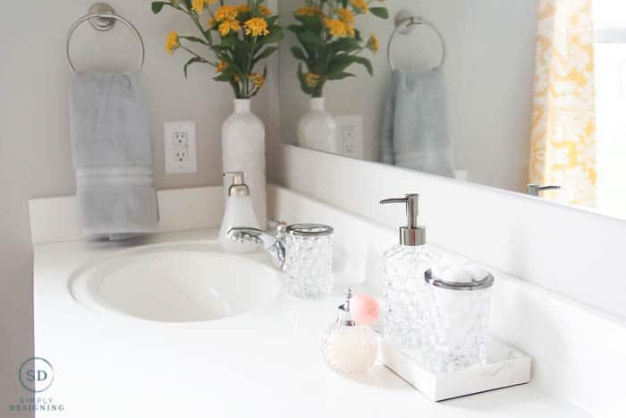 close up of counter decorated in an affordable master bathroom makeover