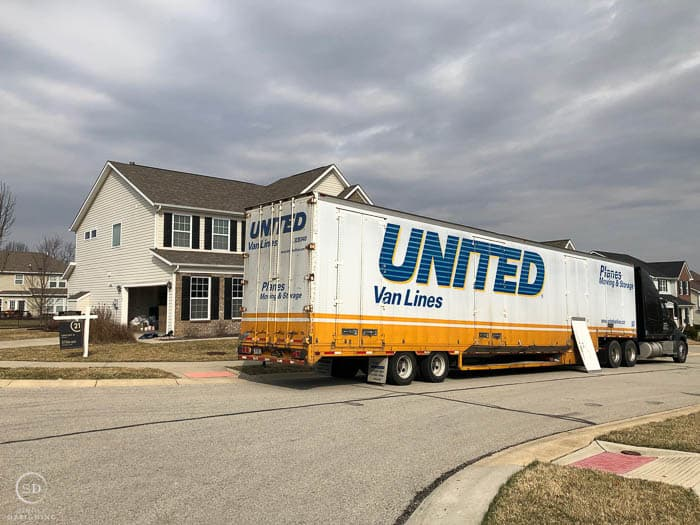 We Moved - moving truck in front of house