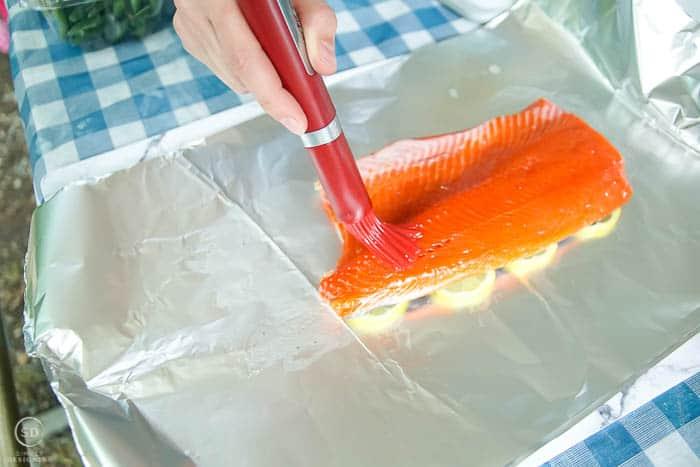 brush honey lemon glaze on salmon