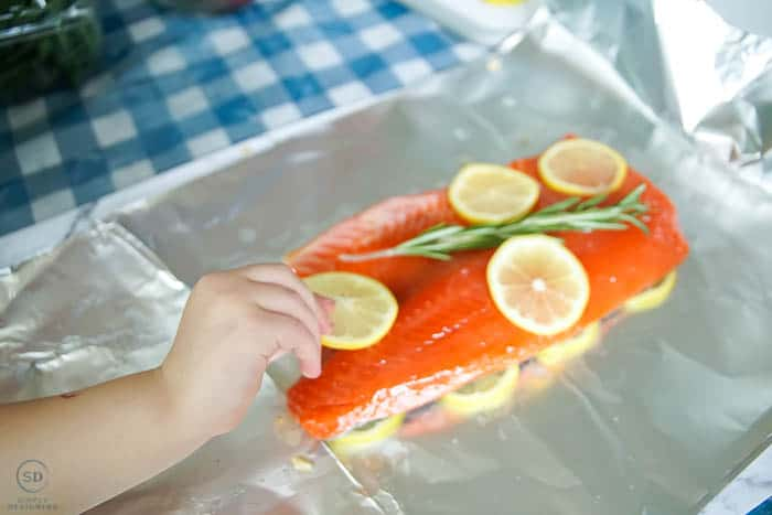 place lemons on honey lemon salmon
