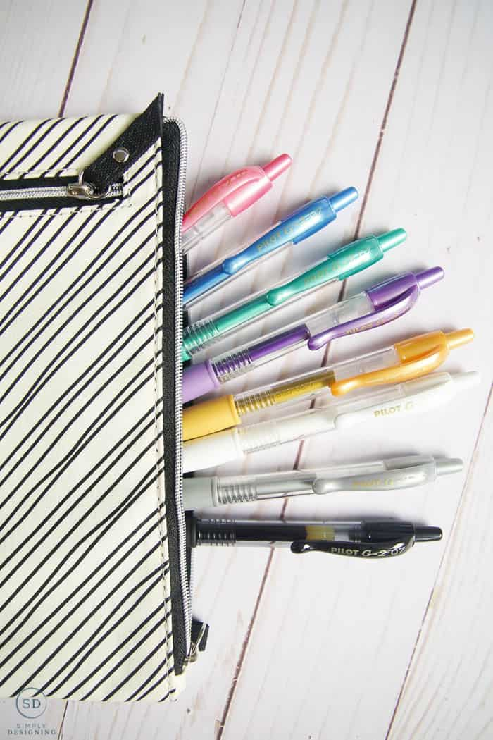 pens in black and white pen case