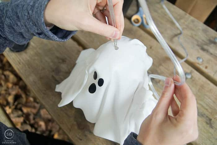 feed lamp cord through hole in hanging ghost lantern