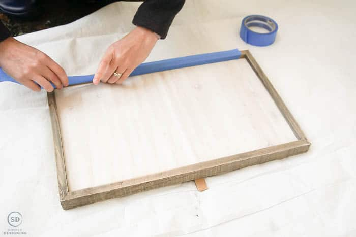 add painters tape to frame