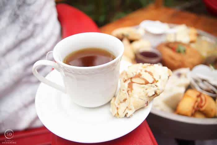 tea cup with peppermint tea and scone