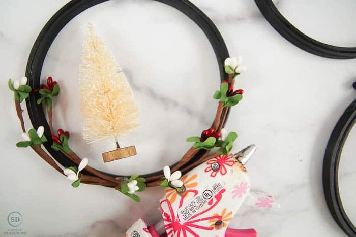 glue bottle brush tree to hoop ornament