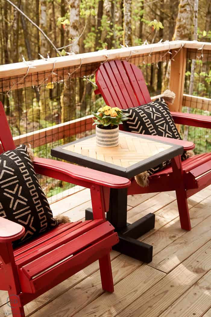 DIY End Table with herringbone pattern and two red adirondack chairs
