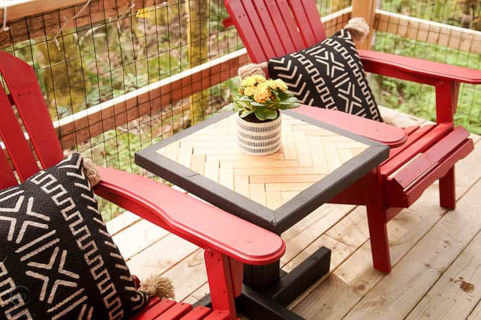 stained herringbone end table with adirondack chairs