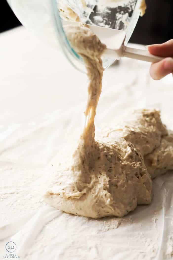 pour dough onto floured surface