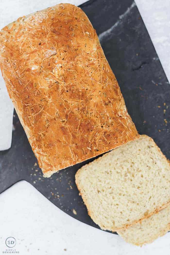 parmesan artisan bread on a black cutting board