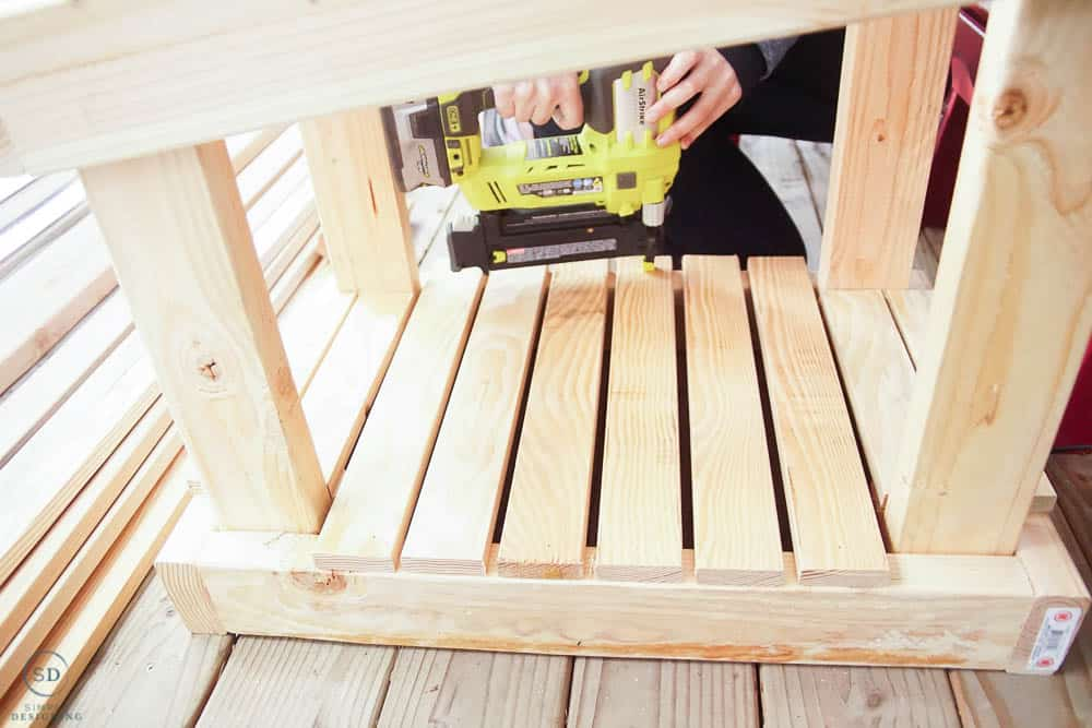use nail gun to attach flooring boards in cat house