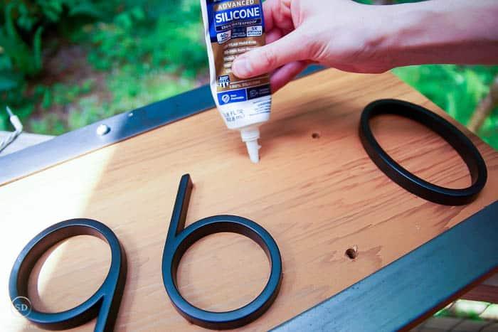 add silicone caulk to holes