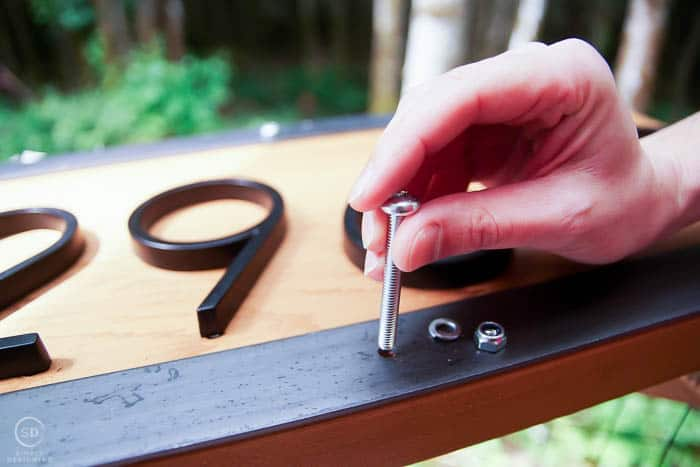 attach flat weld iron to board with bolts and washers