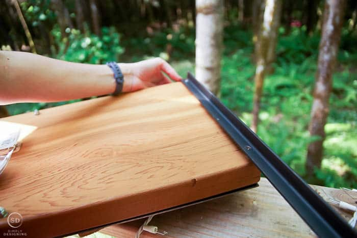 attach angle iron to board for stakes