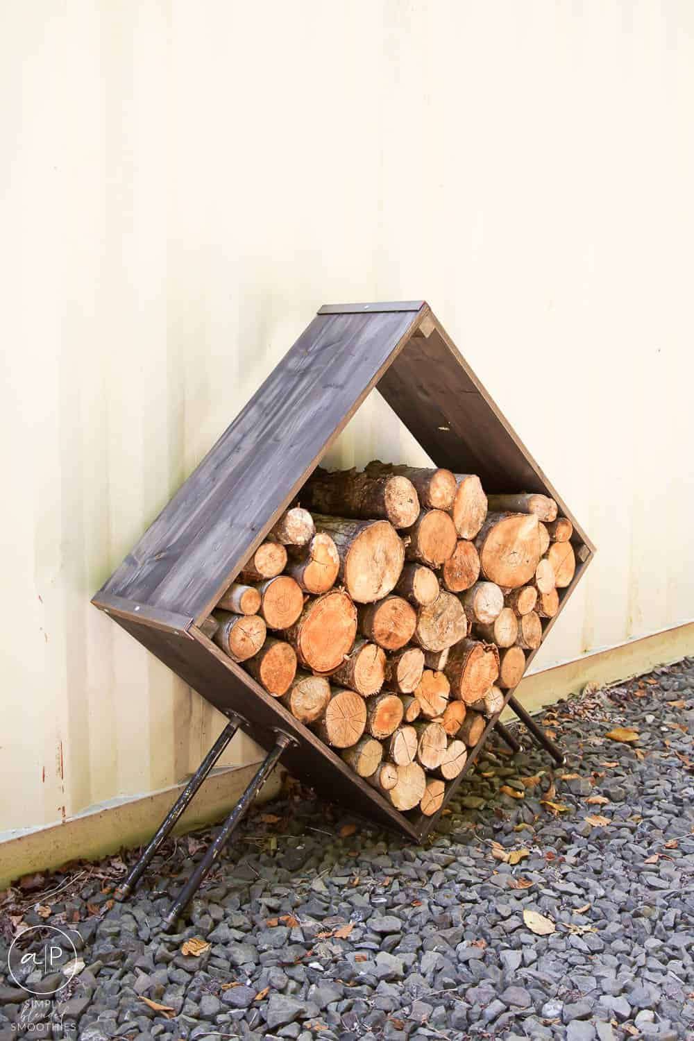 diy firewood holder with pipe legs stained almost black