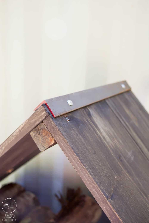close up of corner on firewood rack with angle iron on corners