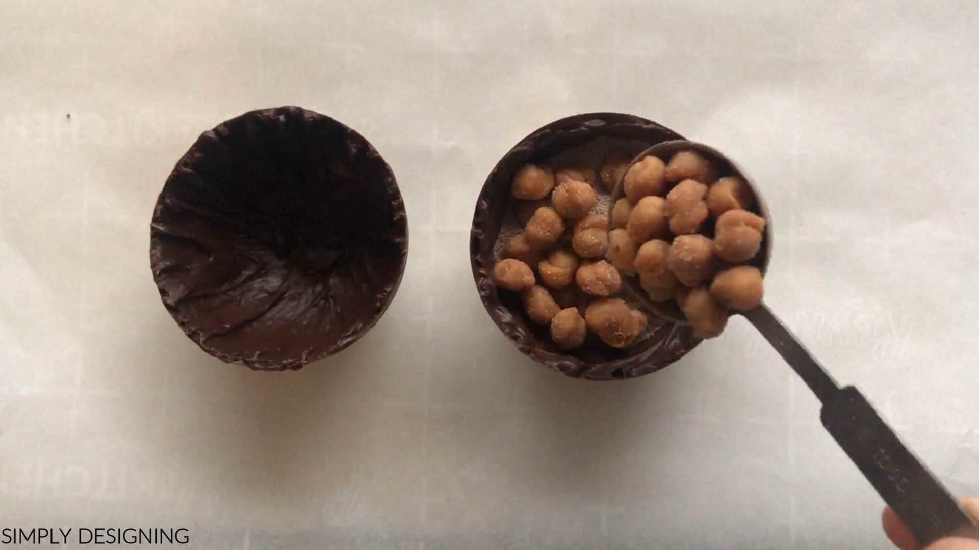 put caramel bits into hollow chocolate spheres for caramel hot chocolate bombs