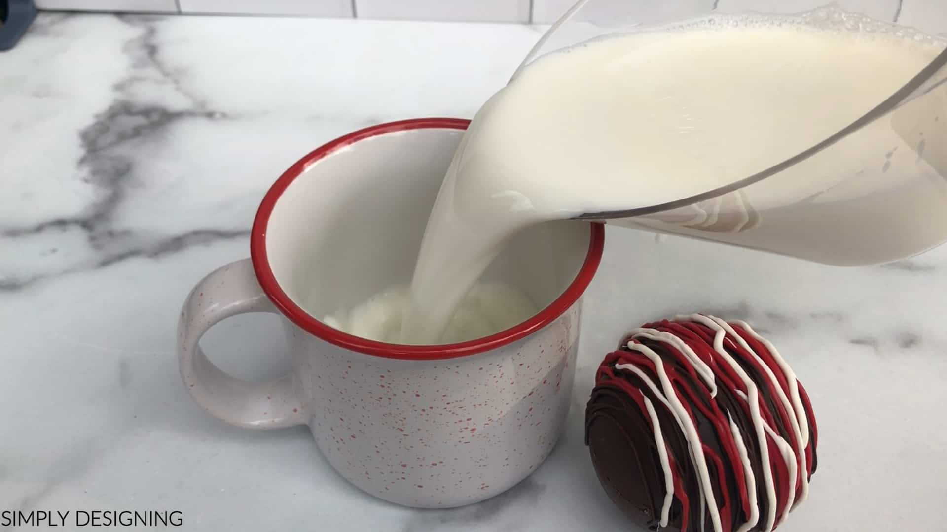 pour steaming milk in mug